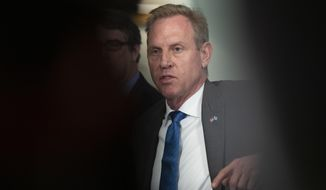 Acting Secretary of Defense Patrick Shanahan responds to reporters' questions regarding an incident in the East China Sea where an American guided-missile cruiser and a Russian destroyer came within 165 feet (50 meters) of each other, during a meeting with visiting Greek Defense Minister Evangelos Apostolakis at the Pentagon, Friday, June 7, 2019. (AP Photo/Manuel Balce Ceneta)