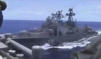 In this image from video provided by the U.S. Navy, a Russian destroyer, left, sails very close to the USS Chancellorsville, right, while operating in the Philippine Sea, Friday, June 7, 2019. The U.S. and Russian militaries accused each other of unsafe actions in the incident. (Photo by Petty Officer 1st Class Christopher J Krucke via AP)