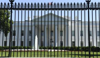 The fence surrounding the White House on Pennsylvania Avenue in Washington, Friday, May 24, 2019. Approval was given for a new and taller fence around the White House complex in 2017 and now construction of a almost 13-foot tall fence is slated to begin this summer. (AP Photo/Susan Walsh)