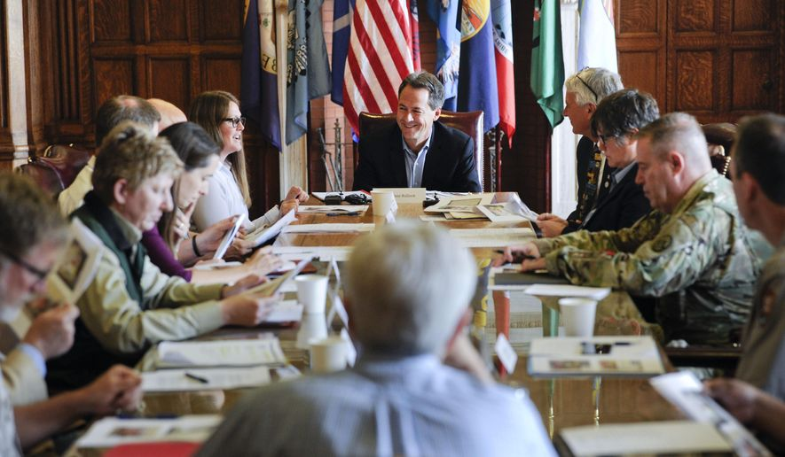 Montana Gov. Steve Bullock meets with local, state and federal officials for a briefing on the upcoming wildfire season, Friday, June 7, 2019, at the State Capitol in Helena, Mont. (Thom Bridge/Independent Record via AP)