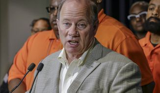 "Detroit Mayor Mike Duggan speaks during a press conference, Friday, June 7, 2019, at the Detroit Police Headquarters in Detroit, addressing the police response to a possible serial killer. Investigators believe a ""serial murderer and rapist"" targeting prostitutes is at large in Detroit. (Kimberly P. Mitchell/Detroit Free Press via AP)"