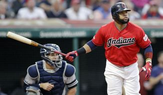 Cleveland Indians' Carlos Santana watches his two-run home run off New York Yankees starting pitcher Domingo German during the sixth inning in a baseball game Friday, June 7, 2019, in Cleveland. Yankees catcher Gary Sanchez watches. (AP Photo/Tony Dejak)