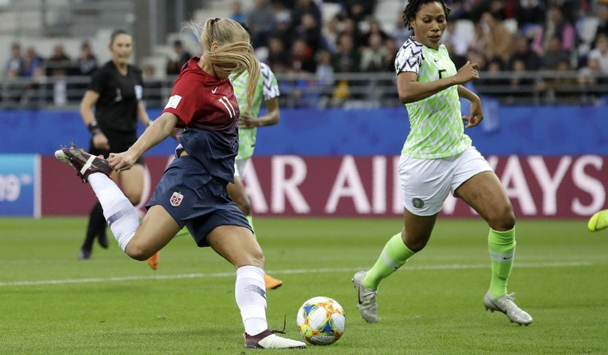 Norway's Lisa-Marie Utland, left, kicks the ball past Nigeria's Onome Ebi to score her team's second goal during the Women's World Cup Group A soccer match between Norway and Nigeria at stadium Auguste Delaune in Reims, France, Saturday, June 8, 2019. (AP Photo/Alessandra Tarantino)
