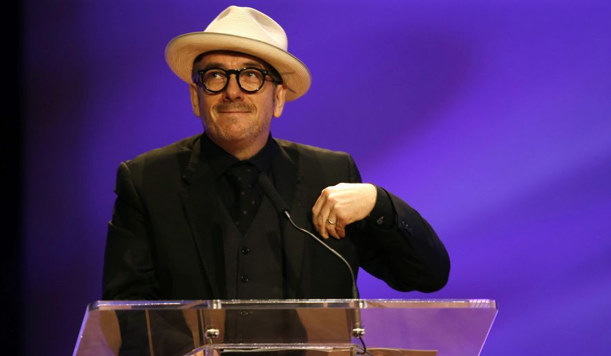 In this Friday, Nov. 20, 2015, file photo, Elvis Costello smiles during a funeral tribute to Allen Toussaint in New Orleans. (AP Photo/Gerald Herbert, file)