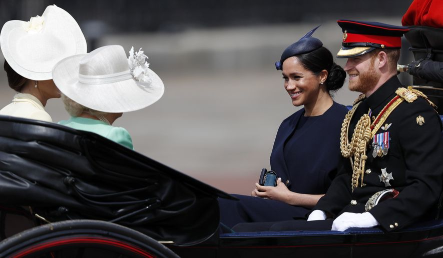 Britain's Meghan, the Duchess of Sussex and Prince Harry ride in a carriage to attend the annual Trooping the Colour Ceremony in London, Saturday, June 8, 2019. Trooping the Colour is the Queen's Birthday Parade and one of the nation's most impressive and iconic annual events attended by almost every member of the Royal Family. (AP Photo/Frank Augstein)