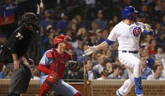 Chicago Cubs' Victor Caratini, right, watches his three-RBI double during the sixth inning of a baseball game as St. Louis Cardinals catcher Matt Wieters, center, and home plate umpire umpire Manny Gonzalez (79) look on Saturday, June 8, 2019, in Chicago. (AP Photo/Jeff Haynes)