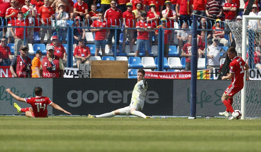Wales goalkeeper Wayne Hennessey fails to save an own goal scored by Wales defender James Lawrence during the Euro 2020 group E qualifying soccer match between Croatia and Wales at the Gradski Vrt stadium in Osijek, Croatia, Saturday, June 8, 2019. (AP Photo/Darko Bandic)