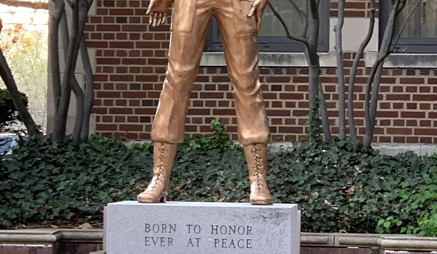 This April 2019 photo, shows a statue of Sharon Lane displayed Aultman Hospital in Canton, Ohio. Lane, a first lieutenant, was killed 50 years ago this week - June 8, 1969 - when a rocket hit the the 312th Evacuation Hospital's Vietnamese ward in Chu Lai. She was 25.  (Scott Heckel/The Canton Repository via AP)