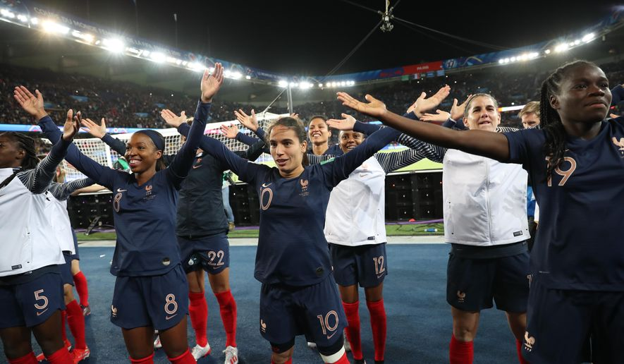 France's players celebrate at the end of the Group A soccer match between France and South Korea on the occasion of the Women's World Cup at the Parc des Princes in Paris, Friday, June 7, 2019. (AP Photo/Francisco Seco)