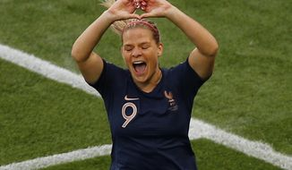 France's Eugenie Le Sommer celebrates after scoring her side's opening goal during the Women's World Cup Group A soccer match between France and South Korea, at the Parc des Princes in Paris, Friday, June 7, 2019. (AP Photo/Francois Mori)