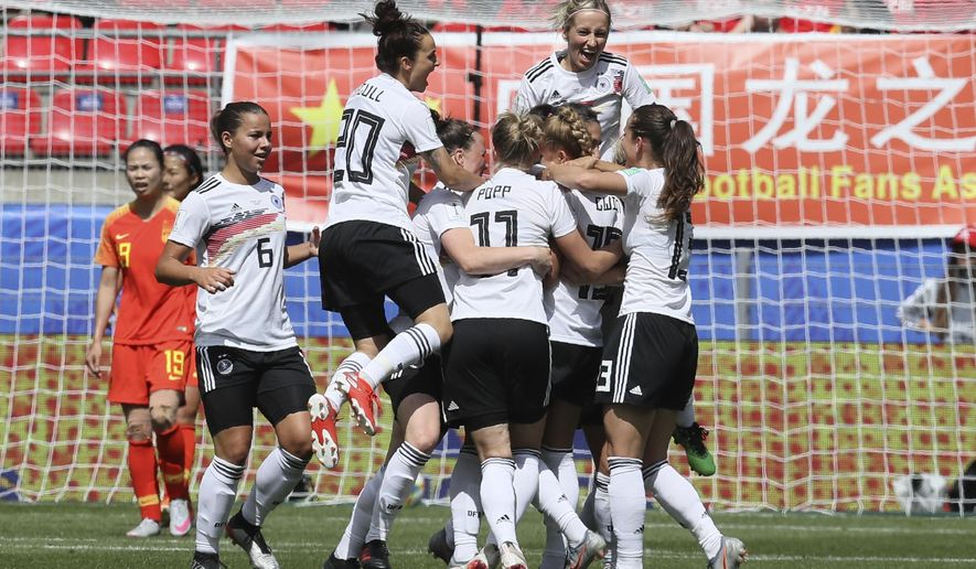 Germany's Giulia Gwinn is cheered by teammates after scoring her side's first goal during the Women's World Cup Group B soccer match between Germany and China, at the Roazhon Park stadium, in Rennes, France, Saturday, June 8, 2019. (AP Photo/David Vincent)