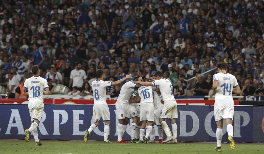 Italy's players celebrate after scoring against Greece, during the Euro 2020 group J qualifying soccer match between Greece and Italy at Olympic stadium in Athens, Saturday, June 8, 2019. (AP Photo/Yorgos Karahalis)