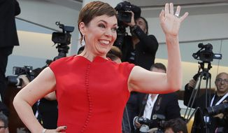 """FILE - In this file photo dated  Saturday, Sept. 8, 2018, Academy Award-winning actress Olivia Colman poses for photographers at the 75th Venice Film Festival in Venice, Italy.  Colman is awarded the title of Commander of the Order of the British Empire, or CBE, on Friday June 7, 2019, in the annual Queen's Birthday Honors list, honoured by Britain's Queen Elizabeth II, the monarch that Colman plays in the new TV drama """"The Crown."""" (AP Photo/Kirsty Wigglesworth, FILE)"""