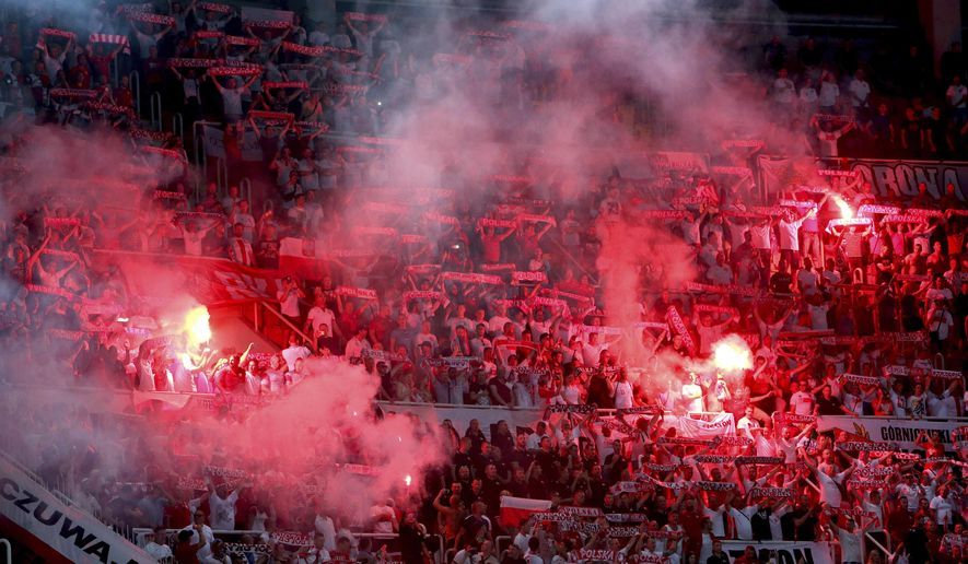 Poland's fans light flares supporting their team during the Euro 2020 group G qualifying soccer match at National Arena Todor Proeski in Skopje, North Macedonia, Friday, June 7, 2019. (AP Photo/Boris Grdanoski)