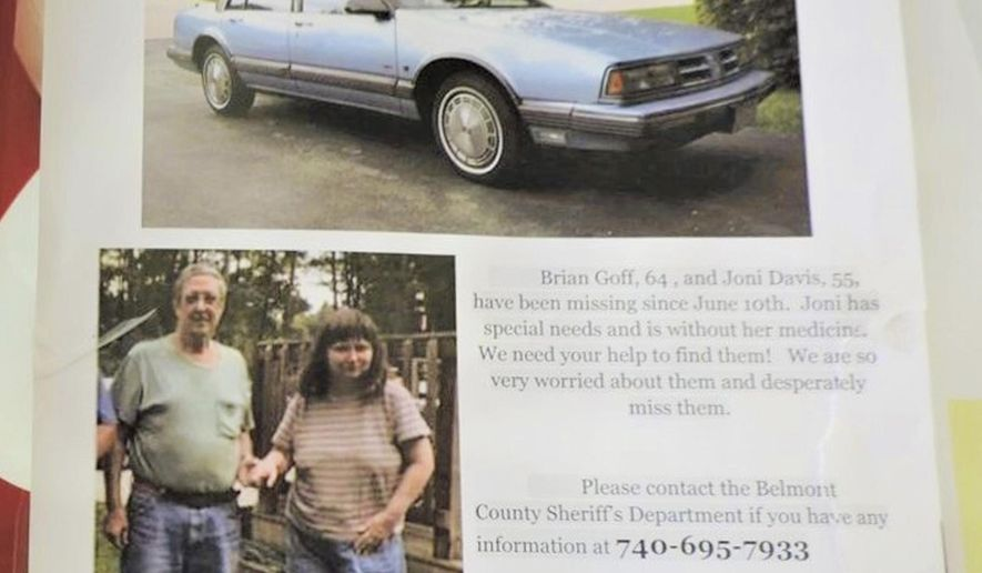 This flyer posted around town in Martins Ferry, Ohio shows Brian Goff and Joni Davis, both missing since June 10, 2018. Family members and law enforcement officials agree there is little hope in eastern Ohio that a mild-mannered couple last seen a year ago is alive today along with the belief their deaths came violently. (AP Photo/The Times Leader)