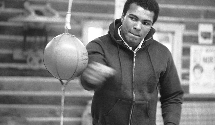 FILE -- In this Jan. 10, 1974 file photo, Muhammad Ali punches a bag in his Deer Lake, Pa., training camp where he was preparing for his rematch with Joe Frazier. The rustic Pennsylvania training camp where Ali prepared for some of his most famous fights has undergone an elaborate restoration. The camp in Deer Lake opened to the public Saturday, June 1, 2019 as a shrine to his life and career. (AP Photo/ Rusty Kennedy)