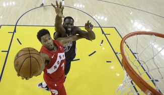 Toronto Raptors guard Kyle Lowry (7) shoots in front of Golden State Warriors forward Draymond Green during the second half of Game 4 of basketball's NBA Finals in Oakland, Calif., Friday, June 7, 2019. (AP Photo/Tony Avelar, Pool)