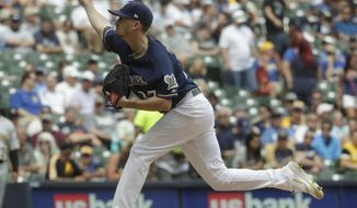 Milwaukee Brewers starting pitcher Zach Davies throws during the first inning of a baseball game against the Pittsburgh Pirates Saturday, June 8, 2019, in Milwaukee. (AP Photo/Morry Gash)