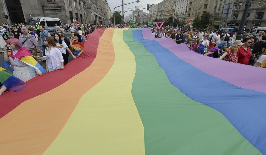 People take part in a gay pride parade in Warsaw, Poland, on Saturday, June 8, 2019. The Equality Parade is the largest gay pride parade in central and Eastern Europe. It brought thousands of people to the streets of Warsaw at a time when the LGBT rights movement in Poland is targeted by hate speeches and a government campaign depicting it as a threat to families and society. (AP Photo/Czarek Sokolowski)