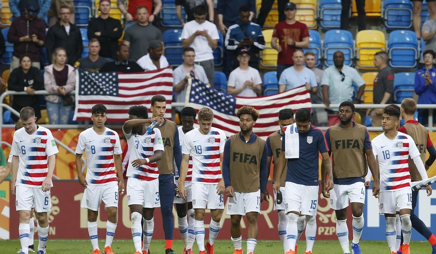 United States players walk on the pitch after their team's 1-2 loss during the quarter final match between USA and Ecuador at the U20 World Cup soccer in Gdynia, Poland, Saturday, June 8, 2019. (AP Photo/Darko Vojinovic)