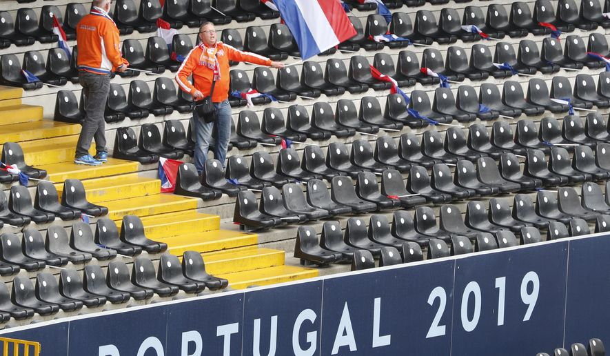 A Dutch soccer fan waves a state flag prior to the UEFA Nations League semifinal soccer match between Netherlands and England at the D. Afonso Henriques stadium in Guimaraes, Portugal, Thursday, Jun. 6, 2019. (AP Photo/Armando Franca)