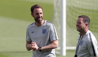 England manager Gareth Southgate, left, smiles during a a training session at their training ground in Guimaraes, Portugal, Saturday, June 8, 2019. England will play Switzerland in the UEFA Nations League third place soccer match Sunday. (AP Photo/Luis Vieira)