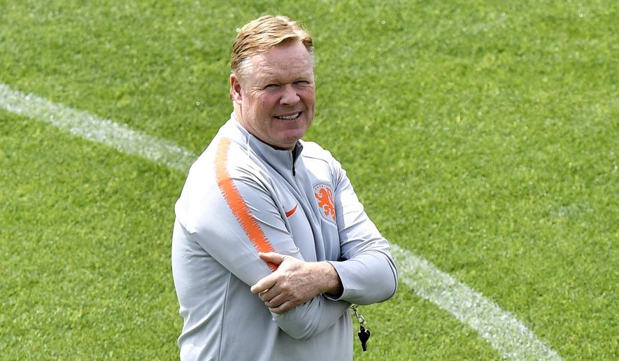 Netherlands coach Ronald Koeman watches up during a training session at their training ground in Braga, Portugal, Saturday, June 8, 2019. Netherlands will play Portugal in the UEFA Nations League final soccer match on Sunday in Porto, Portugal. (AP Photo/Martin Meissner)