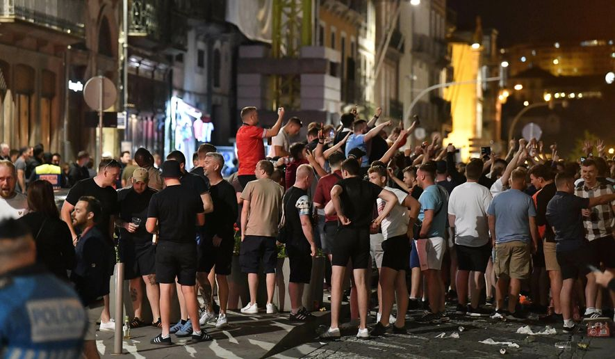 English supporters drink and sing on Friday, June 7, 2019 in the city center of Porto, Portugal, the day after England lost their UEFA Nations League semifinal soccer match against the Netherlands. England will play Switzerland in a third place play-off match on upcoming Sunday. (AP Photo/Martin Meissner)
