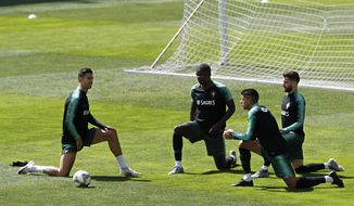 From left, Portugal's Cristiano Ronaldo, William Carvalho, Joao Cancelo and Rafa Silva stretch during a soccer training session at the Bessa stadium in Porto, Portugal, Friday, June 7, 2019. Portugal will play Netherlands in the UEFA Nations League final on Sunday. (AP Photo/Armando Franca)