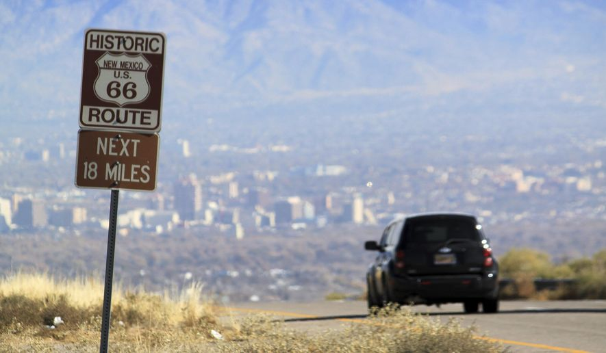 FILE - In this Nov. 19, 2014 file photo a car travels down historic Route 66 toward Albuquerque, N.M. New Mexico's largest city is the latest to embark on upgrades to its portion of the historic Route 66 Highway. (AP Photo/Susan Montoya Bryan,File)