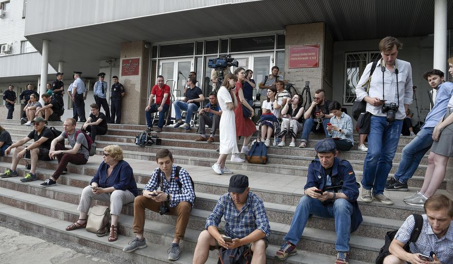 Journalists and supporters of Ivan Golunov, a journalist who worked for the independent website Meduza, gather at a court building in Moscow, Russia, Saturday, June 8, 2019. A prominent Russian investigative journalist has been charged with drug dealing after four grams of the synthetic stimulant mephedrone were found in his backpack, Moscow police said Friday. (AP Photo/Dmitry Serebryakov)