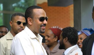 Ethiopia's prime minister Abiy Ahmed arrives in Khartoum, Sudan on Friday, June 7, 2019,  to try and mediate between the ruling military and the country's protest leaders amid an army crackdown that has killed over 100 people this week. Ahmed first met with Sudanese generals who in April ousted longtime autocrat Omar al-Bashir and took over the country after four months of mass protests against his rule. The protesters, however, remained in the streets, demanding the military hand over power to civilians.  (AP Photo)