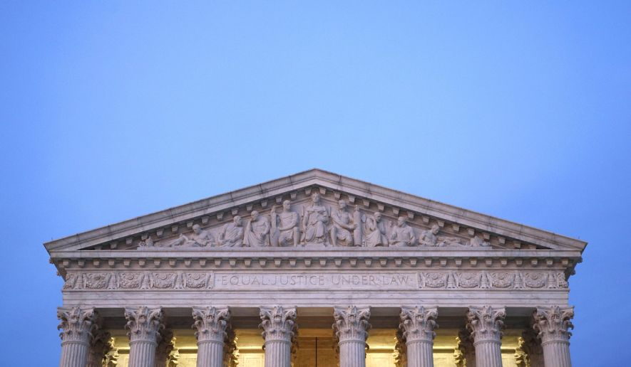 In this May 23, 2019, photo, the U.S. Supreme Court building at dusk on Capitol Hill in Washington. Virginia is holding legislative elections Tuesday, but a case awaiting a Supreme Court ruling could, in an unlikely scenario, result in revisions to about two dozen political districts and, in theory, a new primary within months. (AP Photo/Patrick Semansky)