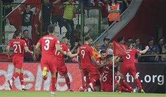 Turkey players celebrate after Cengiz Under scored a goal during the Euro 2020 Group H qualifying soccer match between Turkey and France in Konya, Turkey, Saturday June 8, 2019. (AP Photo)
