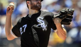 Chicago White Sox starting pitcher Lucas Giolito delivers to a Kansas City Royals batter during the first inning of a baseball game at Kauffman Stadium in Kansas City, Mo., Saturday, June 8, 2019. (AP Photo/Orlin Wagner)