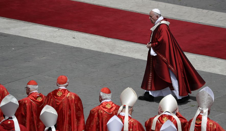 Pope Francis walks past cardinals after celebrating a Pentecost Mass in St. Peter's Square, at the Vatican, Sunday, June 9, 2019. The Pentecost Mass is celebrated on the seventh Sunday after Easter. (AP Photo/Gregorio Borgia)