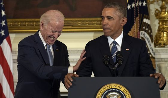 Vice President Joe Biden laughs as President Barack Obama talks about him during a ceremony in the State Dining Room of the White House in Washington, Thursday, Jan. 12, 2017. Obama surprised Biden an presented him with the Presidential Medal of Freedom. (AP Photo/Susan Walsh)