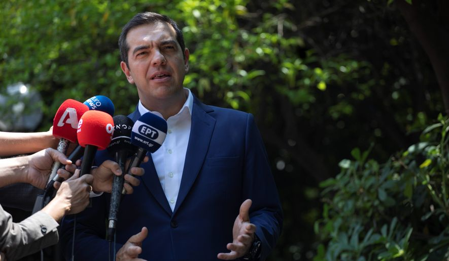 Greek Prime Minister Alexis Tsipras makes a statement to the press outside his office in Athens, on Thursday, June 6, 2019. Tsipras says the results of recent European elections, in which his party suffered a heavy defeat that forced him to call early national elections, has led some in Brussels and in Greece to attempt to undermine his government's decision to introduce new benefits and consumer tax cuts. (AP Photo/Petros Giannakouris)
