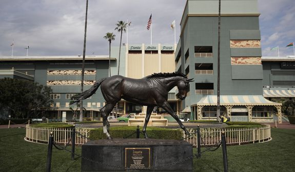 FILE - In this March 5, 2019, file photo, a statue of Zenyatta stands in the paddock gardens area at Santa Anita Park in Arcadia, Calif. A second horse in two days and 29th overall died at Santa Anita, Sunday, June 9, 2019, where management has chosen to continue racing for the rest of the current meet. (AP Photo/Jae C. Hong, File)