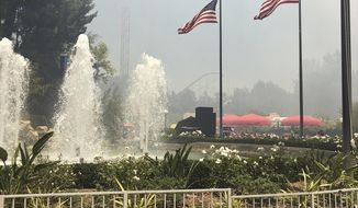 This Sunday, June 9, 2019, photo courtesy of Rachel Gallat, shows the Cafe Plaza when a brush fire first erupted close to Six Flags amusement park in Santa Clarita, Calif. (Rachel Gallat via AP)