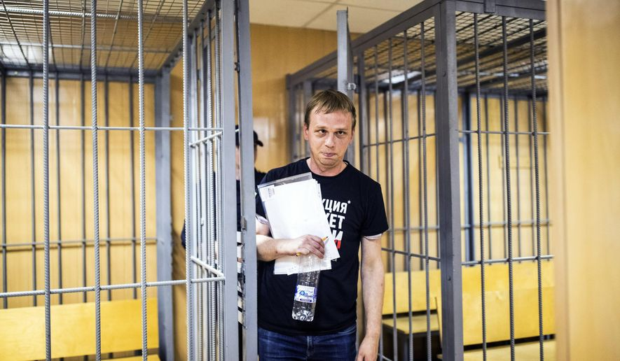In this photo taken on Saturday, June 8, 2019, Ivan Golunov, a prominent Russian investigative reporter, who worked for the independent website Meduza, leaves the cage in a court room in Moscow, Russia. Golunov left the courtroom after the ruling to place him under house arrest until Aug. 7. In the court hearing, he denied being involved with drugs and said he would be willing to help investigators. (Evgeny Feldman/meduza.io via AP)