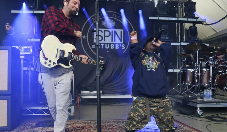 In this March 18, 2016, photo Bushwick Bill, right, joins Deftones' Chino Moreno onstage at the SPIN Party at Stubb's during the South by Southwest Music Festival in Austin, Texas. Representatives of pioneering rapper Bushwick Bill say he is hospitalized in critical condition but still alive, contrary to some reports. (Photo by Jack Plunkett/Invision/AP, File)