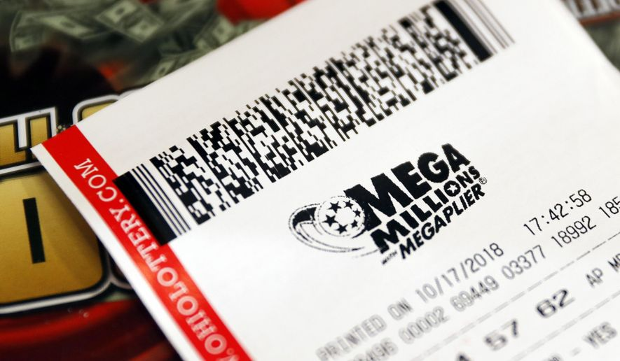 FILE - In this Oct. 17, 2018, file photo a Mega Millions lottery ticket rests on the shop counter at the Street Corner Market in Cincinnati. A lottery ticket worth $530 million in the Mega Millions draw was sold at a liquor store in San Diego, the City News Service reports. (AP Photo/John Minchillo, File)