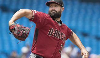 Arizona Diamondbacks starting pitcher Robbie Ray throws against the Toronto Blue Jays in the first inning of a baseball game in Toronto, Sunday, June 9, 2019. (Fred Thornhill/The Canadian Press via AP)