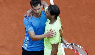 Spain's Rafael Nadal, right, hugs Austria's Dominic Thiem after their men's final match of the French Open tennis tournament at the Roland Garros stadium in Paris, Sunday, June 9, 2019. Nadal won 6-3, 5-7, 6-1, 6-1. (AP Photo/Pavel Golovkin)