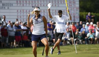 Lexi Thompson celebrates after making a putt for an eagle at the 18th hole to win the LPGA Classic golf tournament, Sunday, June 9, 2019, in Galloway, NJ. (AP Photo/Noah K. Murray)