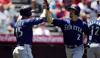 Seattle Mariners' Tom Murphy, right, is congratulated by Kyle Seager after hitting a two-run home run during the second inning of a baseball game against the Los Angeles Angels, Sunday, June 9, 2019, in Anaheim, Calif. (AP Photo/Mark J. Terrill)
