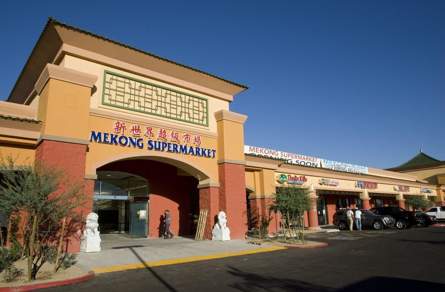 This Oct. 10, 2008, photo shows the exterior of the Mekong Plaza is show in Mesa, Ariz. Dozens of Asian-owned businesses have set up shop in western Mesa, with two large supermarkets serving as anchors for development that includes restaurants and other businesses, is aided by proximity to Mesa Community College and the presence of Arizona State University's main campus in neighboring Tempe. (Mark Henle/The Arizona Republic via AP)