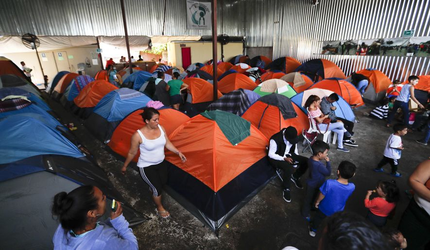 Tents fill a shelter used mostly by Mexican and Central American migrants who are applying for asylum in the U.S., on the border in Tijuana, Mexico, Sunday, June 9, 2019. The mechanism that allows the U.S. to send migrants seeking asylum back to Mexico to await resolution of their process has been running in Tijuana since January. (AP Photo/Eduardo Verdugo)