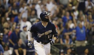 Milwaukee Brewers' Mike Moustakas watches his two- run home run against the Pittsburgh Pirates during the eighth inning of a baseball game, Sunday, June 9, 2019, in Milwaukee. (AP Photo/Jeffrey Phelps)